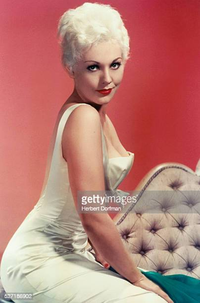Kim Novak Wearing a Sleeveless Evening Gown