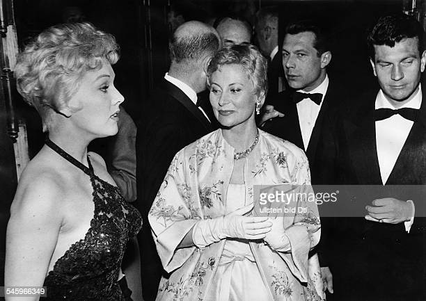 Kim NovakActress USAwith Michelle Morgan and Henri Vidal during the 9th International Film Festival in Cannes 1956