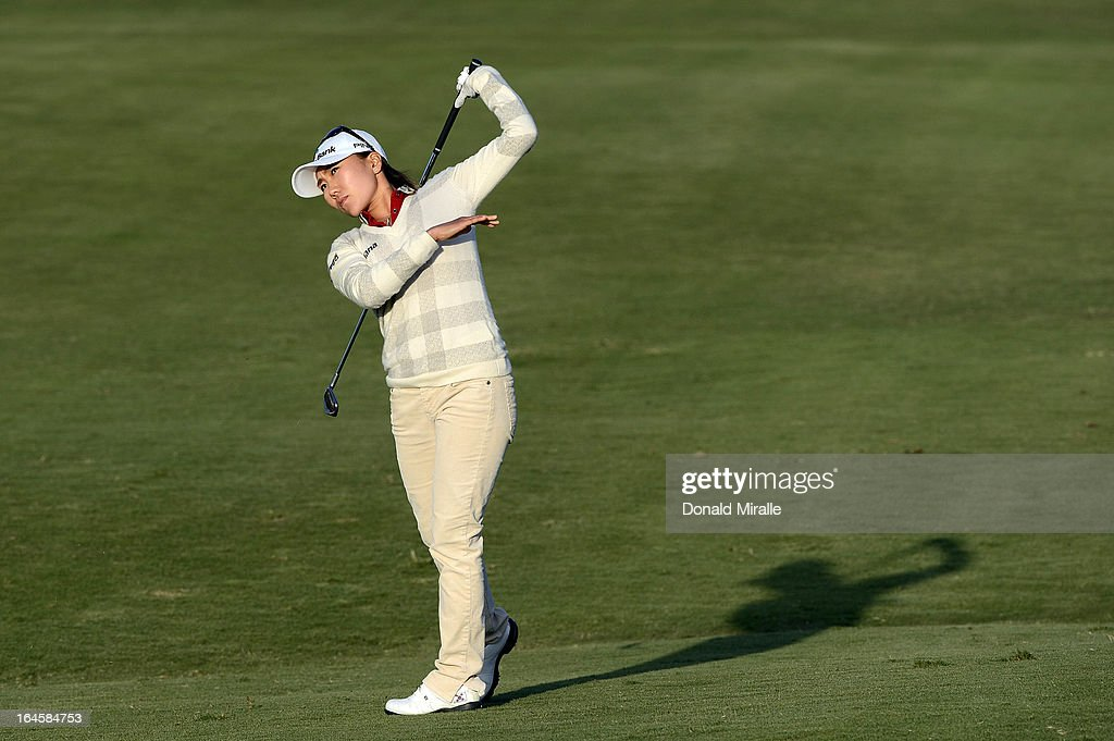 I.K. Kim of South Korea hits her approach shot on the 18th hole, 1st playoff during the Final Round of the LPGA 2013 Kia Classic at the Park Hyatt Aviara Resort on March 24, 2013 in Carlsbad, California.