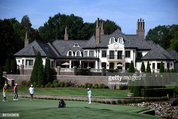 T Kim of South Korea putts on the seventh green during the final round of the 2017 PGA Championship at Quail Hollow Club on August 13 2017 in...