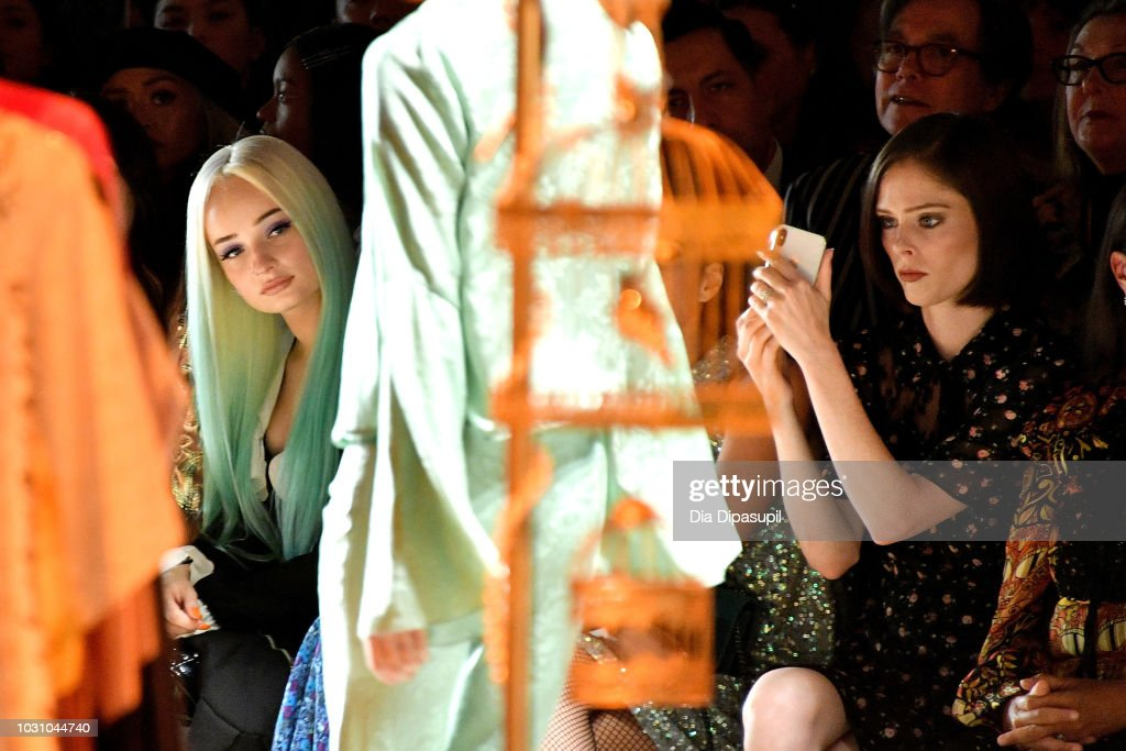 Kim Petras (L) and Coco Rocha attend the Anna Sui front row during New York Fashion Week: The Shows at Gallery I at Spring Studios on September 10, 2018 in New York City.