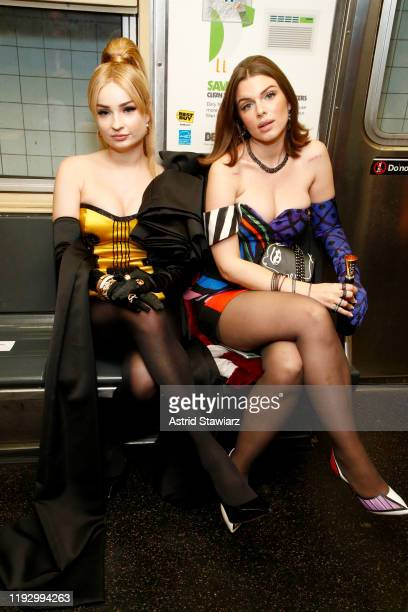 Kim Petras and Julia Fox attend the Moschino Prefall 2020 Runway Show front row at New York Transit Museum on December 09 2019 in Brooklyn City