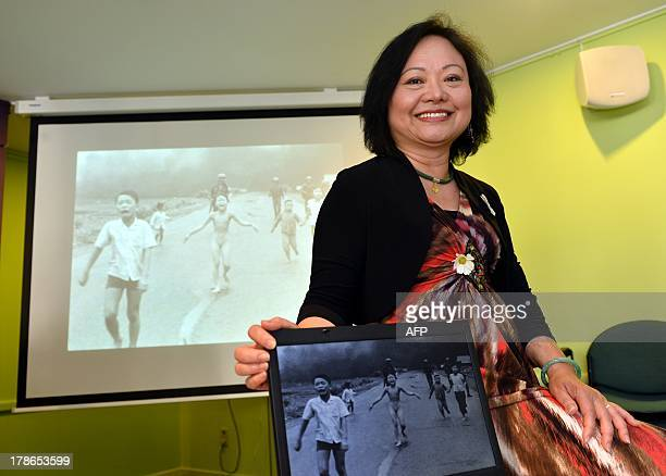 Kim Phuc poses after a meeting of the women's council 'Vrouwenraad' on August 30 2013 in Brussels Vrouwenraad invited Vietnamese born Canadian Phan...