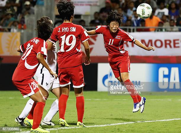 Kim Phyong Hwa of Korea DPR scores her teams second goal during the FIFA U20 Women's World Cup Papua New Guinea 2016 Final between Korea DPR and...