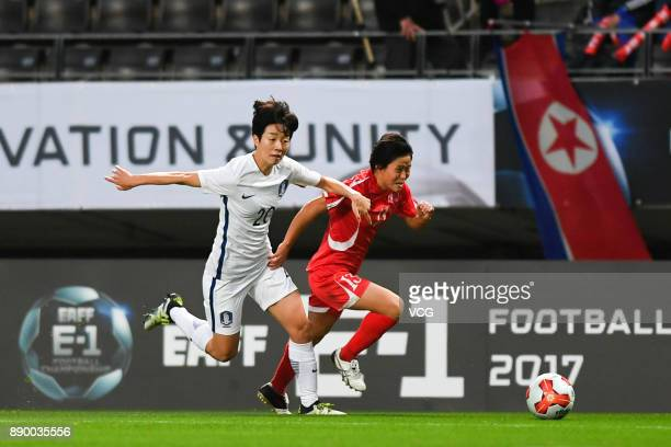 Kim Phyong Hwa of North Korea and Kim Hyeri of South Korea compete for the ball during the EAFF E1 Women's Football Championship between North Korea...