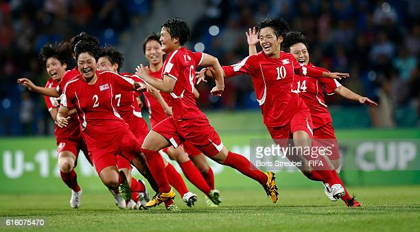 Kim Pom Ui of Korea DPR celebrates with team mates after scoring the last penalty during the FIFA U17 Women's World Cup Finale match between Korea...