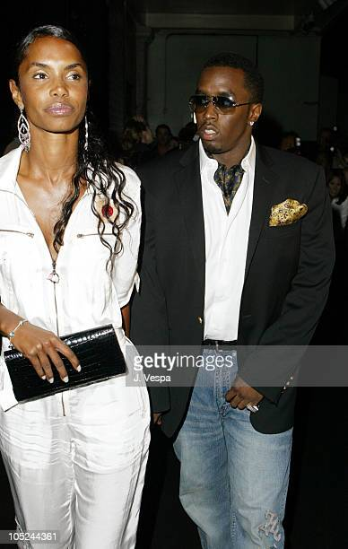 Kim Porter and Sean 'P Diddy' Combs during MercedesBenz Fashion Week Spring 2004 Marc Jacobs Arrivals at New York State Armory in New York City New...