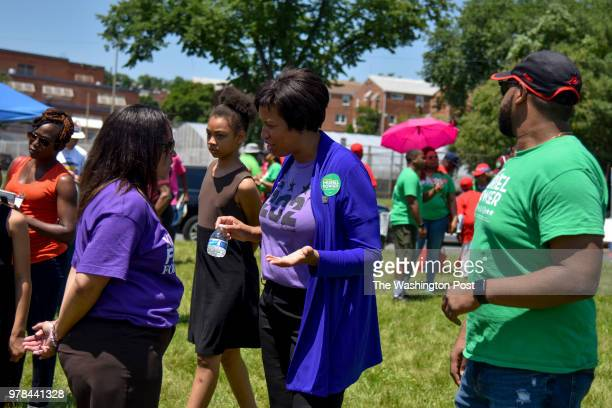 Kim R Ford L a 2018 candidate for congress chats with DC Mayor Muriel Bowser as DC Democrat Candidates rally in Ward 5's Fort Circle Park for a final...