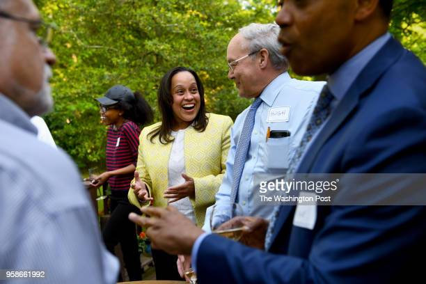 Kim R Ford talks with Hugh Auchincloss along with Bob Kramer left and DC Attorney General Karl Racine right before a living room chat May 08 2018 in...