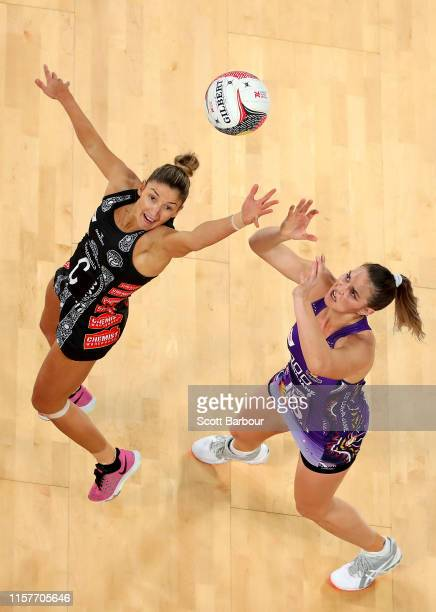 Kim Ravaillion of the Magpies and Gretel Tippett of the Firebirds compete for the ball during the round 9 Super Netball match between the Magpies and...