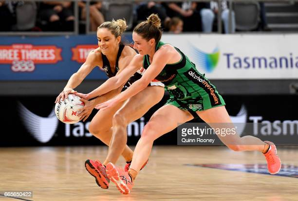 Kim Ravaillion of the Magpies and Ingrid Colyer of the Fever compete for the ball during the round eight Super Netball match between the Magpies and...