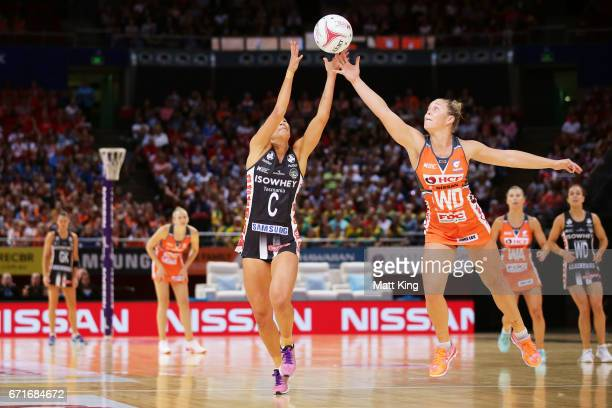 Kim Ravaillion of the Magpies is challenged by JamieLee Price of the Giants during the round nine Super Netball match between the Giants and the...