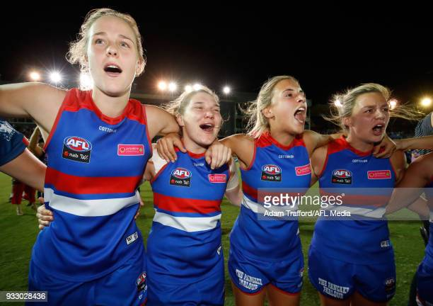 Kim Rennie Kirsty Lamb Bailey Hunt and Deanna Berry of the Bulldogs sing the team song after making it through to the grand final during the 2018...