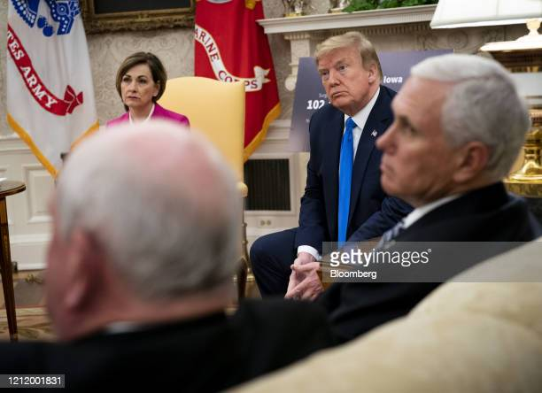 Kim Reynolds governor of Iowa from left US President Donald Trump listens and US Vice President Mike Pence listen during a meeting in the Oval Office...