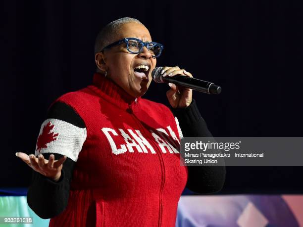 Kim Richardson sings the Canadian anthem at the opening ceremony during the World Short Track Speed Skating Championships at Maurice Richard Arena on...