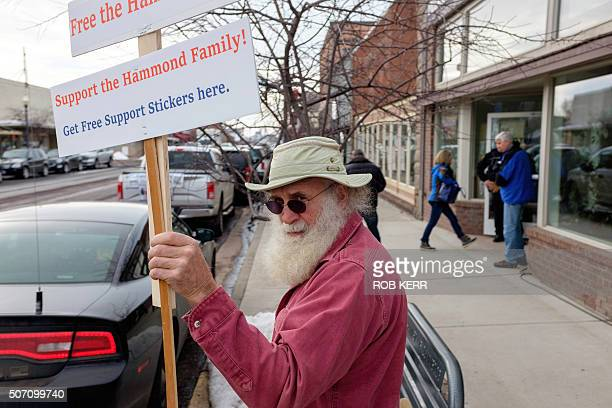 Kim Rollims holds a sign in support of the Hammond Family in front of the Harney County Chamber of Commerce January 27 2016 in Burns Oregon...