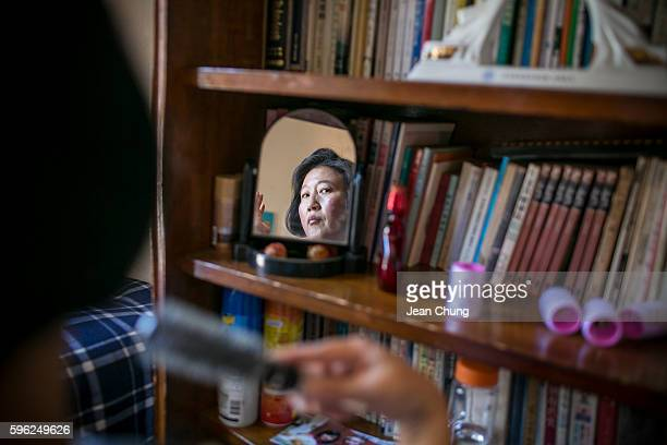 Kim Ryenhi brushes her hair inside a shelter for longterm prisoners originally from North Korea who refused to be defected to South Korea and wish to...