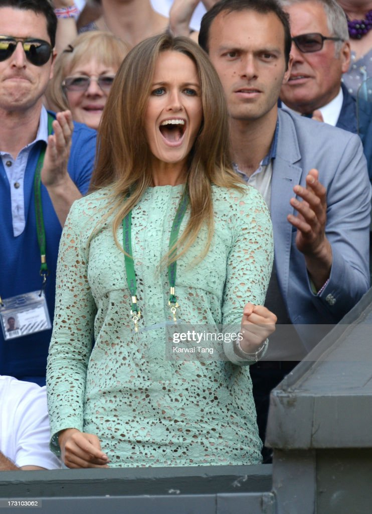 Kim Sears and Ross Hutchins (R) attend the Men's Singles Final between Novak Djokovic and Andy Murray on Day 13 of the Wimbledon Lawn Tennis Championships at the All England Lawn Tennis and Croquet Club on July 7, 2013 in London, England.