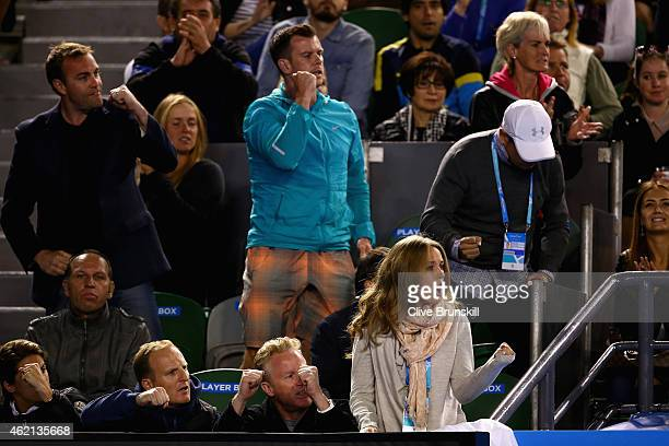 Kim Sears fiancee of Andy Murray of Great Britain celebrates a point as she watches his fourth round match against Grigor Dimitrov of Bulgaria during...