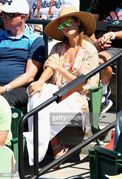 Kim Sears fiancee of Andy Murray of Great Britain watches him in action against Santiago Giraldo of Columbia in their third round match during the...