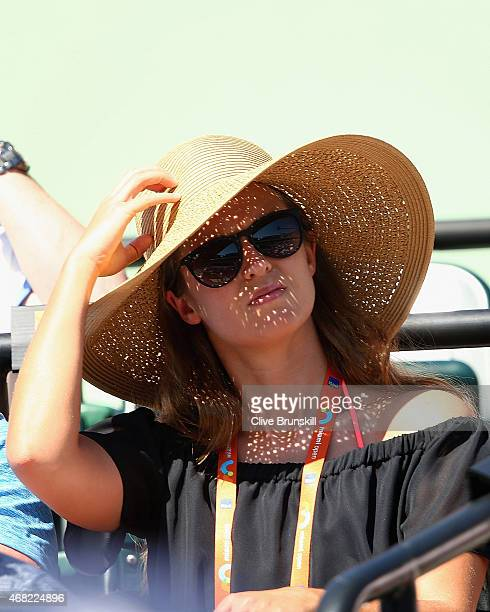 Kim Sears fiancee of Andy Murray of Great Britain watches him play against Kevin Anderson of South Africa in their fourth round match during the...