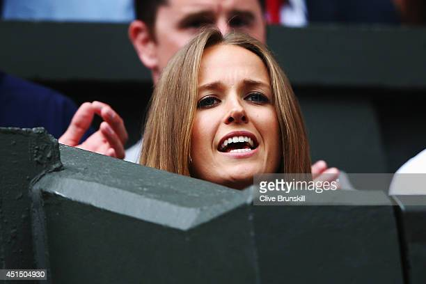 Kim Sears girlfriend of Andy Murray is happy as she watches his Gentlemen's Singles fourth round match against Kevin Anderson of South Africa on day...