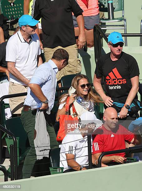 Kim Sears girlfriend of Andy Murray shows her delight after his straight sets victory against JoWilfried Tsonga of France during their fourth round...