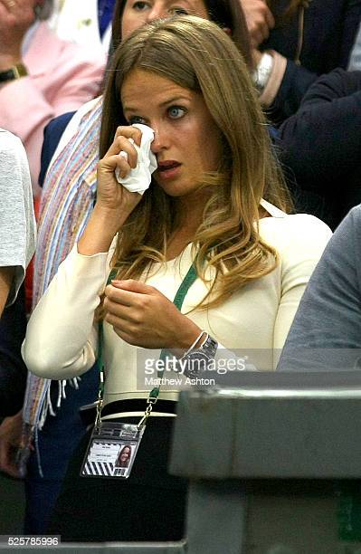 Kim Sears girlfriend of Andy Murray wipes tears from her eyes following the Final at Wimbledon 2012