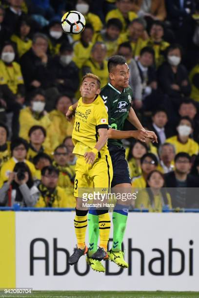 Kim Shin Wook of Jeonbuk Hyundai Motors and Ryuta Koike of Kashiwa Reysol compete for the ball during the AFC Champions League Group E match between...