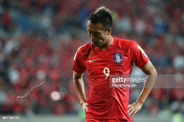 Kim Shin Wook of South Korea spits with frustration after the scoreless draw in the FIFA World Cup Russia Asian qualifier match between South Korea...