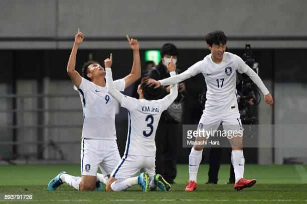 Kim Shinwook of South Korea celebrates scoring his side's first goal with his team mates Kim Jinsu and Lee Jaesung to make it 11 during the EAFF E1...
