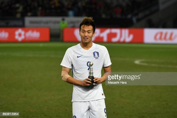 Kim Shinwook of South Korea poses for photographs after receives the Top Scorer award after the EAFF E1 Men's Football Championship between Japan and...