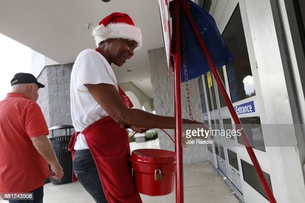 Kim Simmons a bellringer for the Salvation Army collects donations in her red kettle on Giving Tuesday on November 28 2017 in Hallandale Florida...