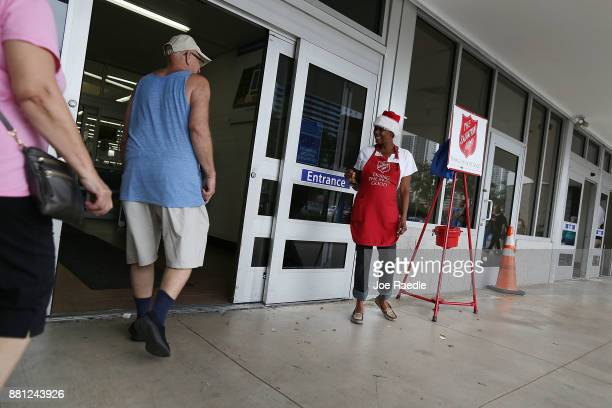Kim Simmons a bellringer for the Salvation Army greets people as she collects money in her red kettle on Giving Tuesday on November 28 2017 in...