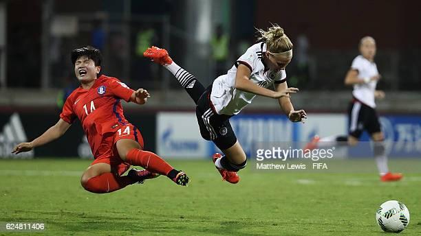 Kim Soeun of Korea Republic and Laura Freigang of Germany collide during the FIFA U-20 Women's World Cup Papua New Guinea 2016 Group D match between...
