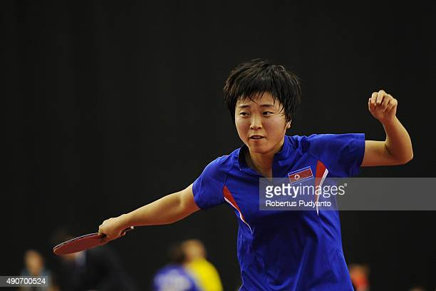 Kim Song I of DPR Korea competes against Yang Haeun of South Korea during Women's singles second round match of the 22nd 2015 ITTF Asian Table Tennis...