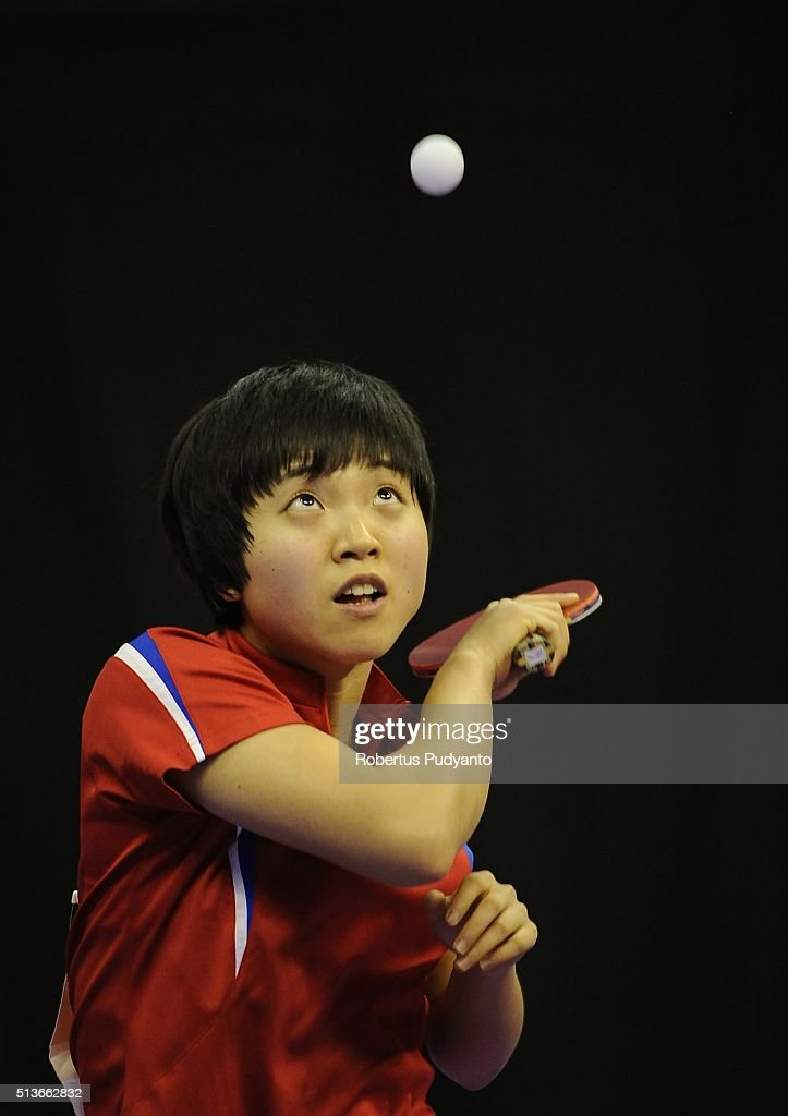 Kim Song I of Korea DPR competes against Yu Mengyu of Singapore during the 2016 World Table Tennis Championship Women's Team Division quarter-final match at Malawati Stadium on March 4, 2016 in Shah Alam, Malaysia.