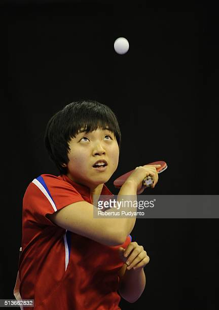 Kim Song I of Korea DPR competes against Yu Mengyu of Singapore during the 2016 World Table Tennis Championship Women's Team Division quarterfinal...