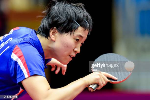 Kim Song I of North Korea competes in the Women's Singles round of 16 match against Miu Hirano of Japan on day two of 2018 ITTF Women's World Cup at...