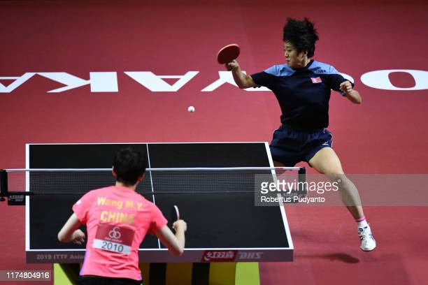 Kim Song I of PRK competes against Wang Manyu of China during day one of the ITTFAsian Table Tennis Championships at Among Raga Stadium on September...