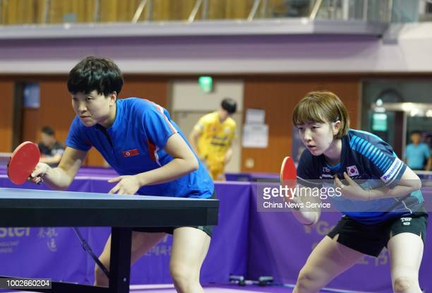 Kim Songi of North Korea and Suh Hyowon of South Korea compete in the Women's Doubles preliminary first round match against Olga Kim and Regina Kim...