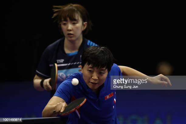 Kim SongI of North Korea and Suh HyoWon of South Korea compete against Wang Manyu and Zhu Yuling of China in the Women's Doubles Round of 16 during...