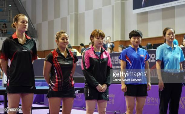 Kim Songi of North Korea and Suh Hyowon of South Korea win the Women's Doubles preliminary first round match against Olga Kim and Regina Kim of...