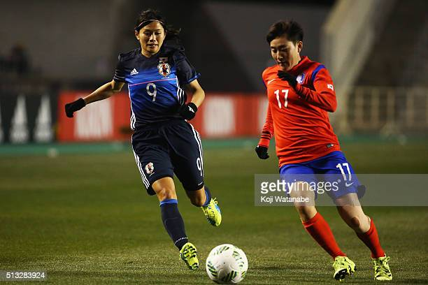 Kim Soo Yun of South Korea and Nahomi Kawasumi of Japan compete for the ball during the AFC Women's Olympic Final Qualification Round match between...