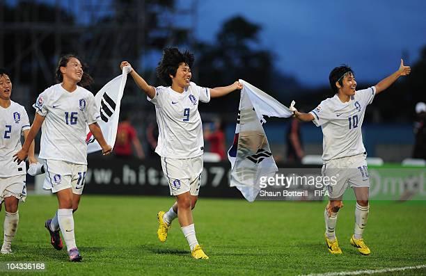 Kim Soobin Kim Dahye and Yeo Min Ji of South Korea celebrate after beating Spain at the end of the FIFA U17 Women's World Cup Semi Final match...