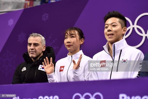kim South Korea's Kim Kyueun and alex South Korea's Alex Kang Chan Kam react after competing in the pair skating short program of the figure skating...
