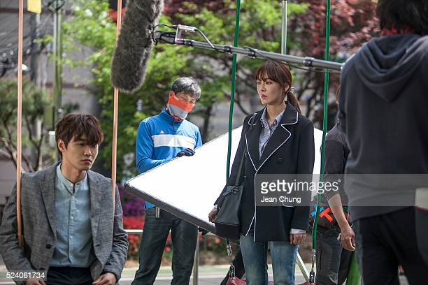 Kim So-yeon, at right, and Jang In-seob, at left, act on the set of a South Korean TV drama 'Gahwamansasung' or Bong's Happy Restaurant by MBC on...