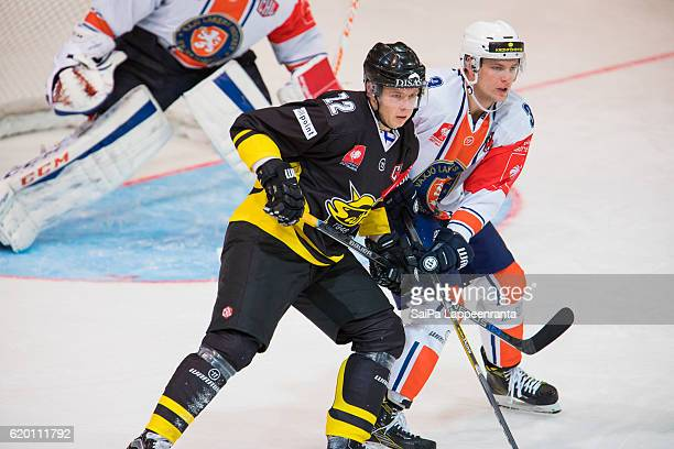 Kim Stromberg of Lappeenranta challenges Oliver Bohm of Vaxjo during the Champions Hockey League Round of 16 match between SaiPa Lappeenranta and...