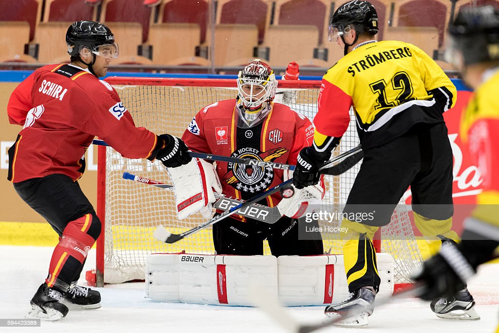 Kim Stromberg #12 of SaiPa Lappeenranta struggles whit Craig Schira #6 of Lulea Hockey in front of Filip Gustafsson #30 Goaltender of Lulea Hockey during the Champions Hockey League match between Lulea Hockey and SaiPa Lappeenranta at Coop Norrbotten Arena on August 23, 2016 in Lulea, Sweden.