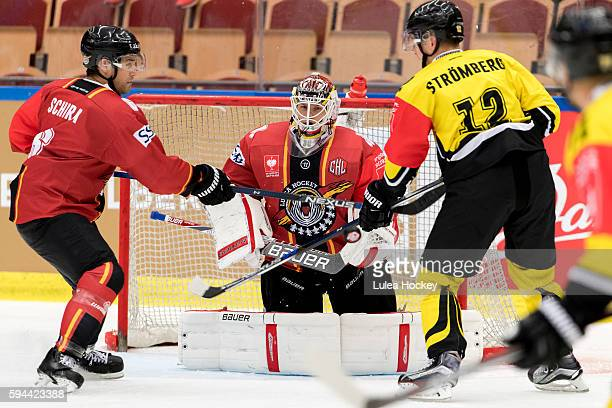Kim Stromberg of SaiPa Lappeenranta struggles whit Craig Schira of Lulea Hockey in front of Filip Gustafsson Goaltender of Lulea Hockey during the...